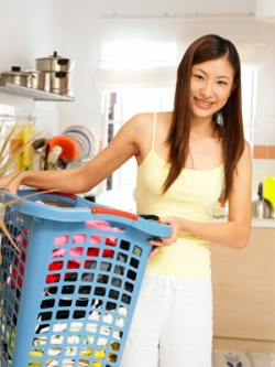 Women Sorts Laundry For Large Family