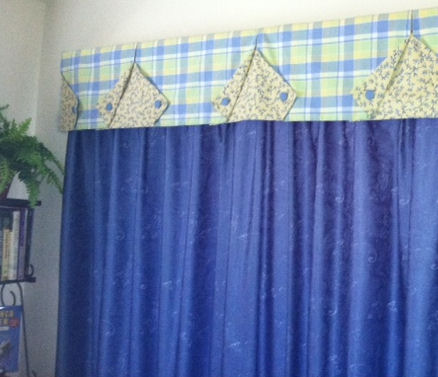I love finding new uses for old things. The plaid part of this valance was once a rectangular tablecloth for our patio table.