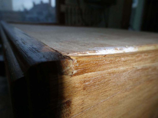 Plywood placed on bottom of drawer shows little wear at the front.