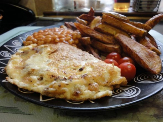 Omelette and chips with baked beans