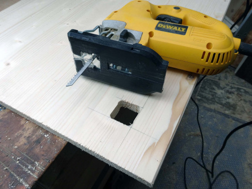 Using a jig saw to cut the squares
