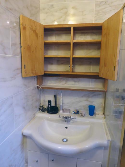 Bathroom cabinet designed with adjustable shelves.