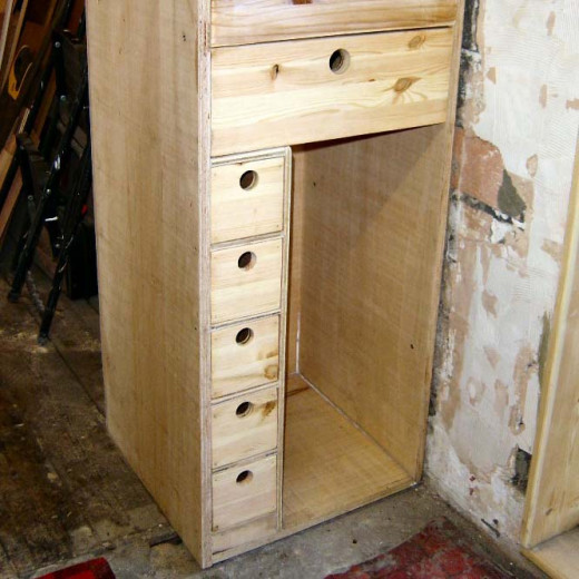 Drawer, spice drawers and pull down flap on built in larder