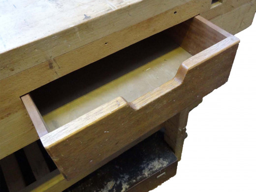 Wooden drawer in workbench