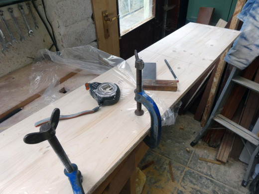 Cut the doors to size from a sheet of pine panel.