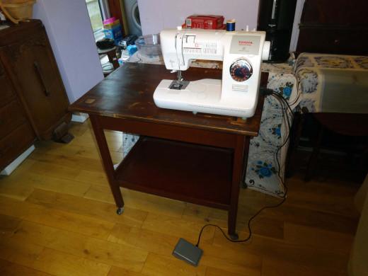 Sewing machine can be stored on bottom shelf, and when required placed on the table top