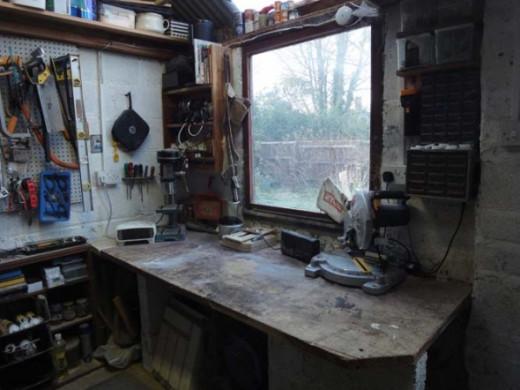 Old office desk utilised as workbench