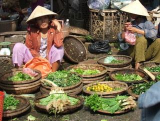 Market sellers, Hoi An, Vietnam