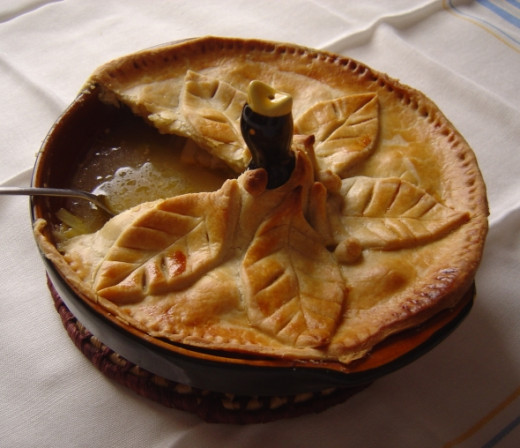 This is my pie showing how the pie bird holds up the crust and lets out steam. Four and twenty blackbirds - no just one but isn't ti sweet?