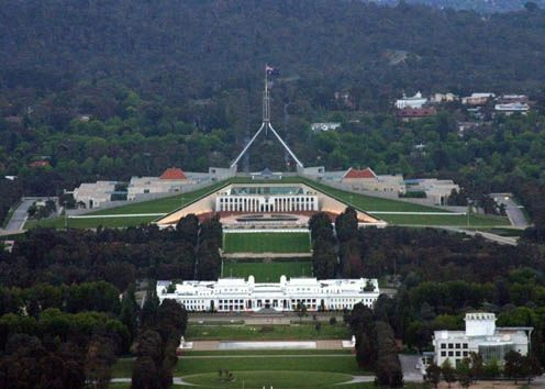 The new Parliament House sits behind the old Parliament House.