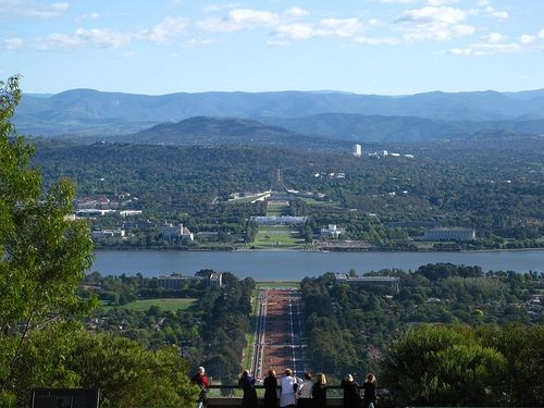 View from Mount Ainslie directly above the War Memorial looking straight towards the old and new Parliament Houses.