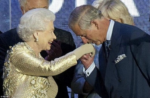 Prince Charles kissing the Queen