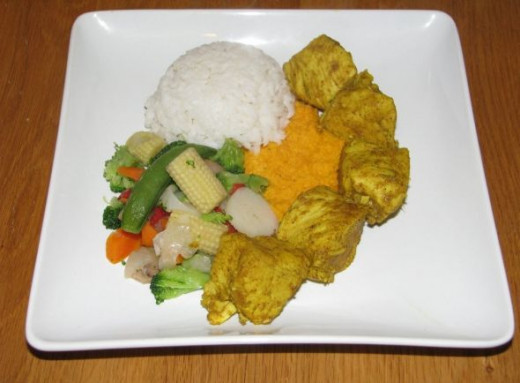 Curry Chicken with Rice, Steamed Veggies, and Carrot Puree