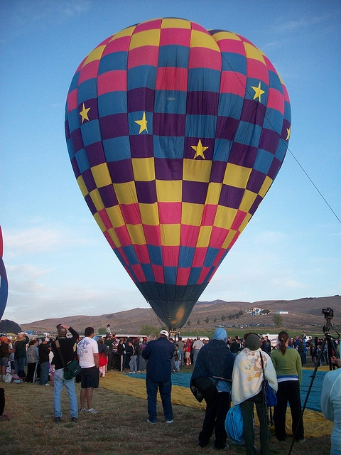 Hot air balloon lifting off