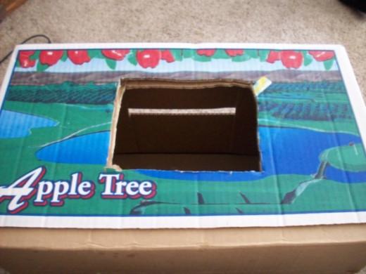 Hole cut through the box
