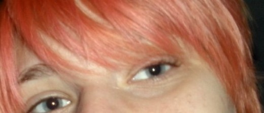 This is a faded-out pink on a natural blonde head. It kind of went to a sherbert-color but it still looks unique.