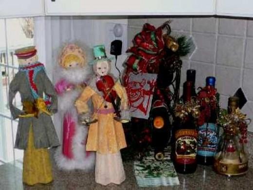 A few handmade  paper mache Carolers keep  my wine selection company.