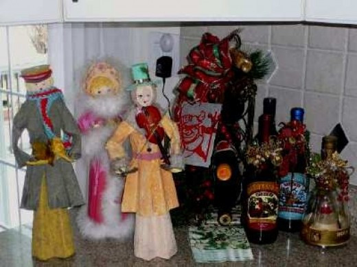 A few handmade  paper mache Carolers keep  my wine selection company.