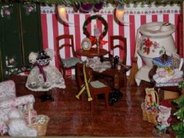 Mrs. Claus's sewing room, looks as if her Christmas frock is almost completed.