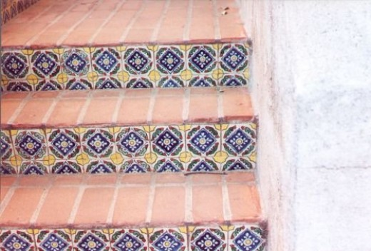 Mexican tile decorating the stairs. A person can go into Nogales and buy these from vendors who lay their wares out on the sidewalk.