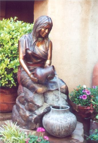 Woman pouring water - fountain.