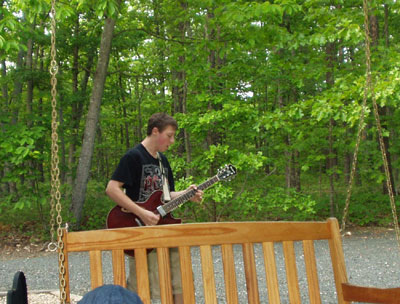 Scott playing his electric guitar.