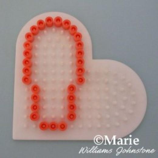 Outline of the shoe shape on a heart shaped board