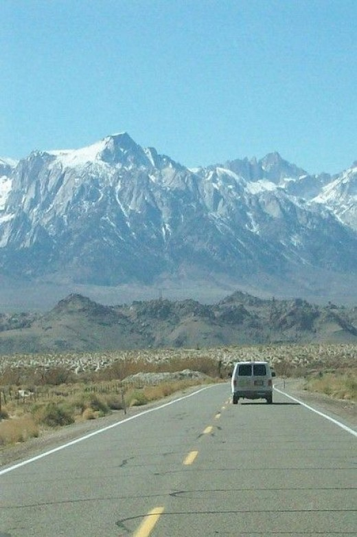 Driving toward Mt. Whitney and Lone Pine Peak on the Eastern Face of the Sierra Nevada, with the Alabama Hills at their base.