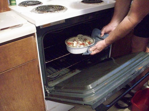 Sliding the Zucchini Dish into the Oven