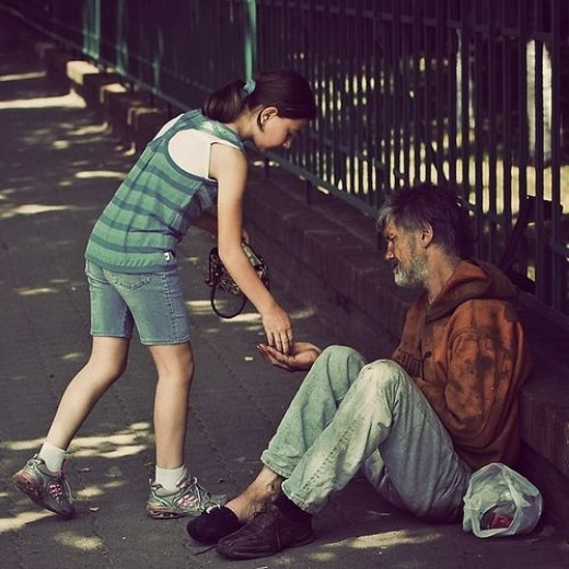 This young lady is giving money to a poor man.