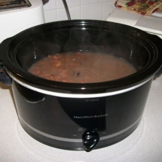 Cooking pinto beans in my crock pot.