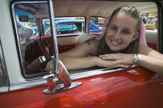 50s costumed girl driving a classic car.