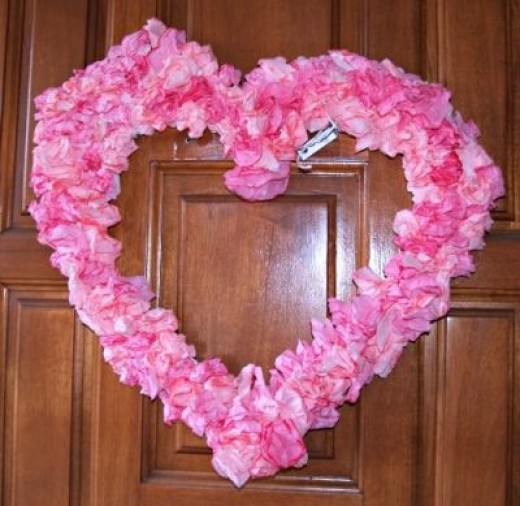 This wreath is made from foam core and coffee filters, and hangs on my own front door.