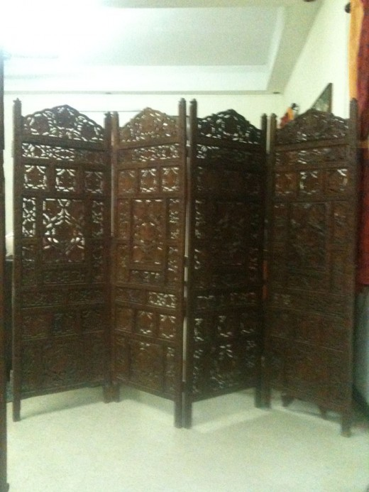 The 4 Panel Wooden Screen kept open.