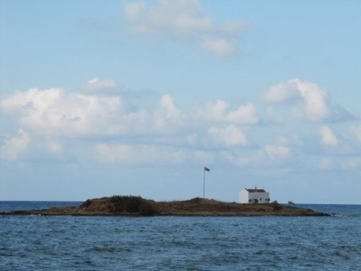 A tiny island in the sea. Wouldn't want to live there!