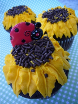 Sunflower & Ladybug Cupcake photo by Amanda Linton via Flicker, copyright 2010