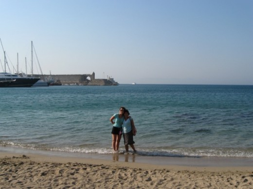 Beach in Rhodes with the castle of the Knights of St. John in the background