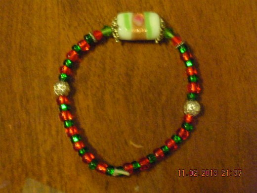 NEWEST (nov)  holiday bracelet with a piece of 'hard candy' as the decoration. making another but my designs are 1 of a kind so  it will be different