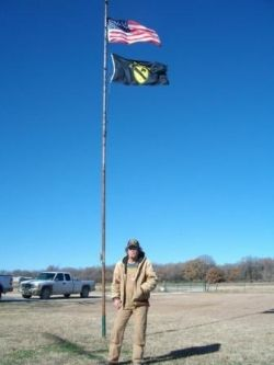 My husband in front of his flag pole, 2009