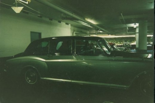 "The Beverly Hilton""s Limousine was a1969 Silver Cloud Rolls Royce pewter over grey body with red leather cabin with imported wood trim. (green tint is caused by fluorescent lights in garage)"