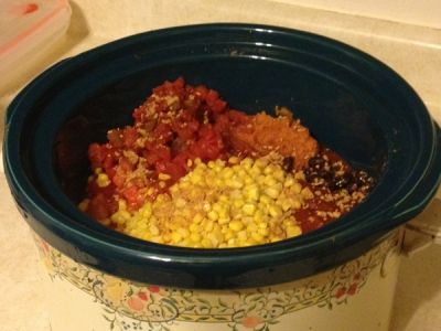 Add All Tomatoes, Pumpkin, Corn, and Beans Together in Crock Pot.