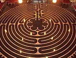 This labyrinth has a single path coiling and turning within a 40-foot perimeter. Laid on the floor of Chartres Cathedral, France.