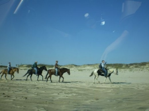 Horseback riding on Matagorda beach, Gulf of Mexico