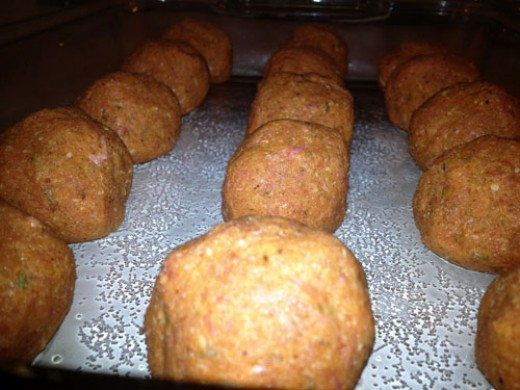 Roll the mixture into round, golf ball sized meatballs and place them on a cookie sheet or in a baking pan.