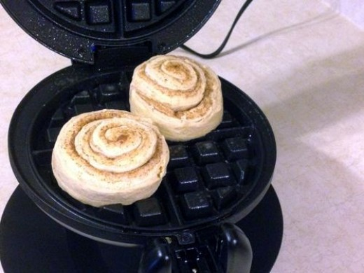 Spray your waffle iron with cooking spray and place two jumbo rolls in the waffle maker and close the lid. Cooking time varies by waffle maker.