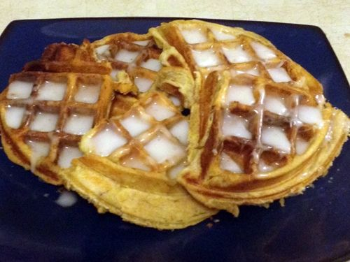 Lift waffles out of the waffle iron and cut into triangles. Use a butter knife to spread the frosting that comes in the cinnamon roll can on top.