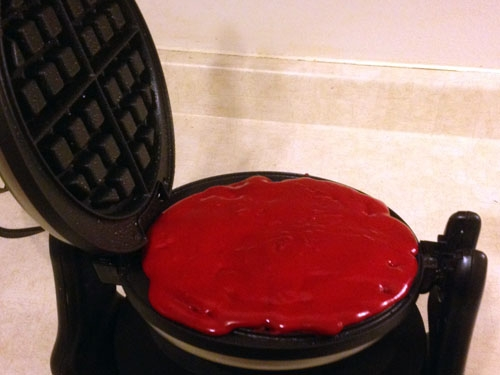 Make sure you spray the waffle irons with cooking spray to avoid sticking. Pour the cake batter into the waffle maker.