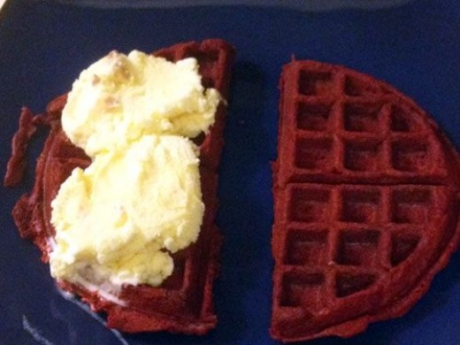 Cut the waffle in half and place two scoops of your favorite ice cream on one half of the waffle.