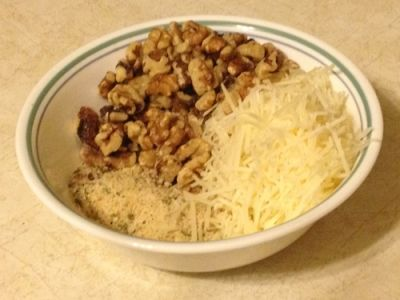 In a Bowl, Combine Bread Crumbs, Parmesan, and Chopped Walnuts.  Add Olive Oil & Mix Well.