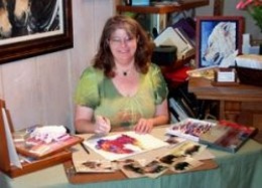 Mona Majorowicz demonstrating oil pastels at a gallery reception
